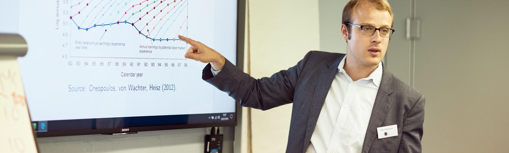 Lecturer points to presentation