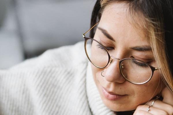 Thoughtful young woman preparing for exam at home